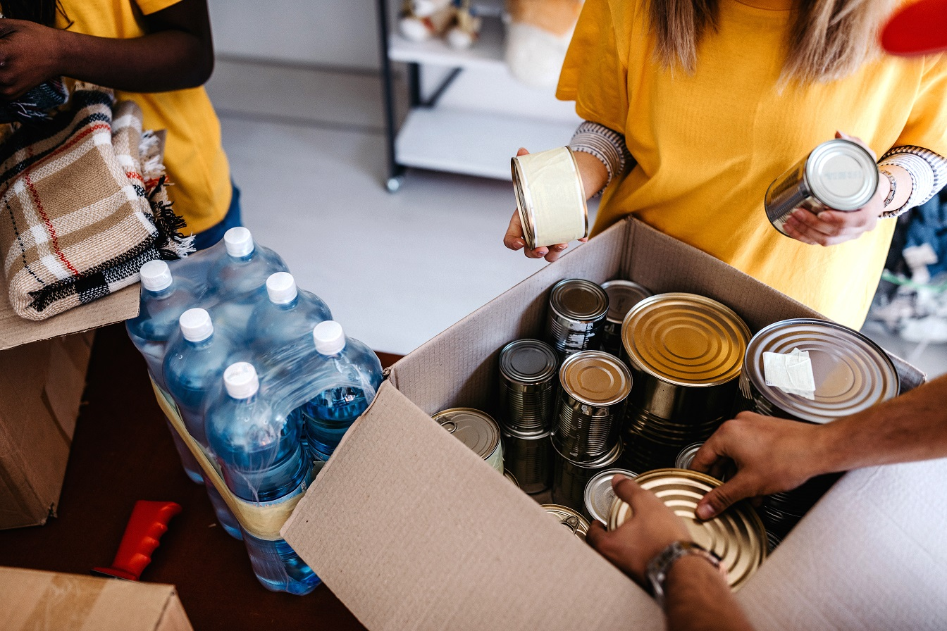 Charity woman with tinned food for National Grid