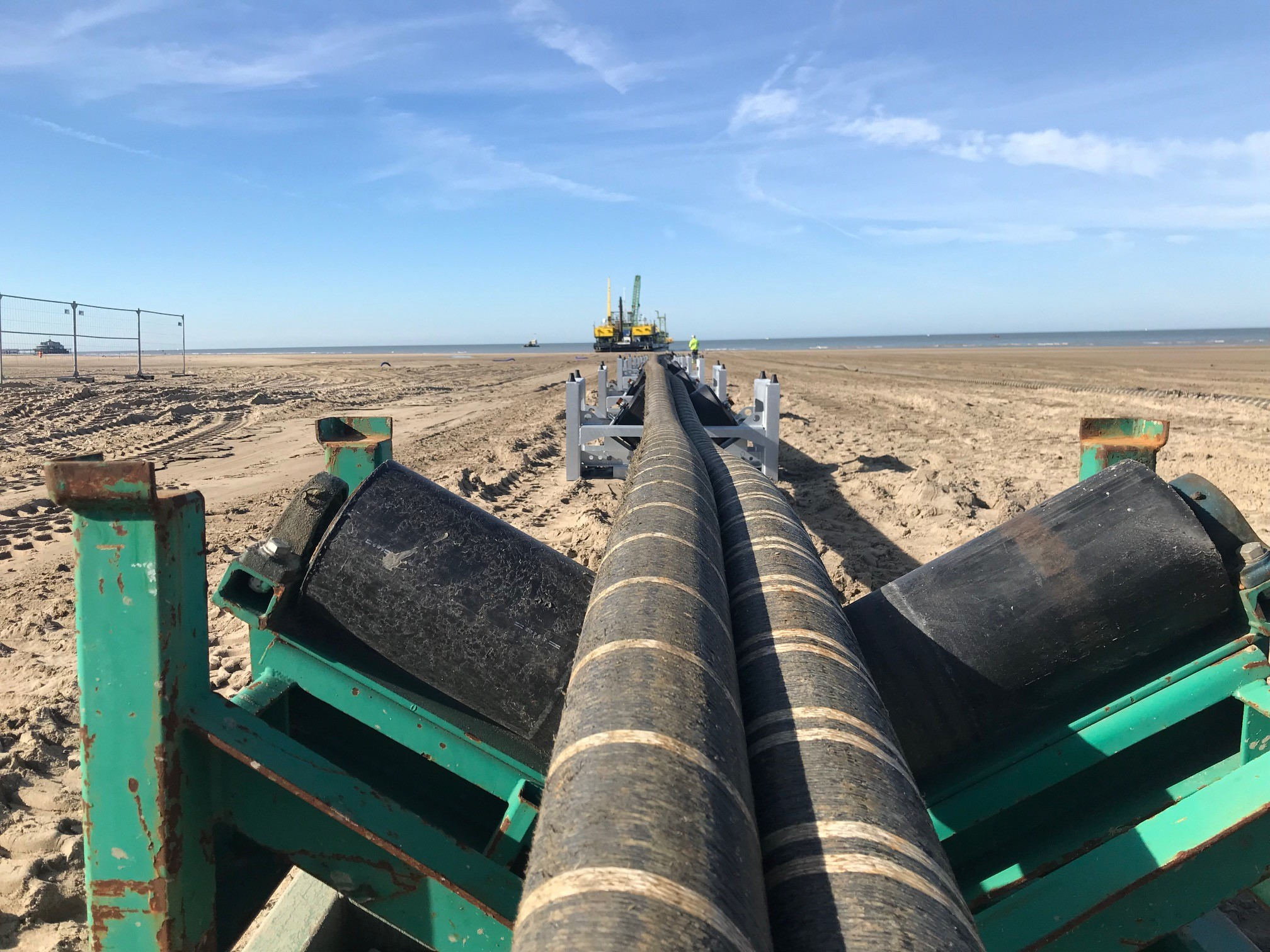 Interconnector cables being pulled across a beach - used for the National Grid article 'Connecting electricity systems for a greener Britain'