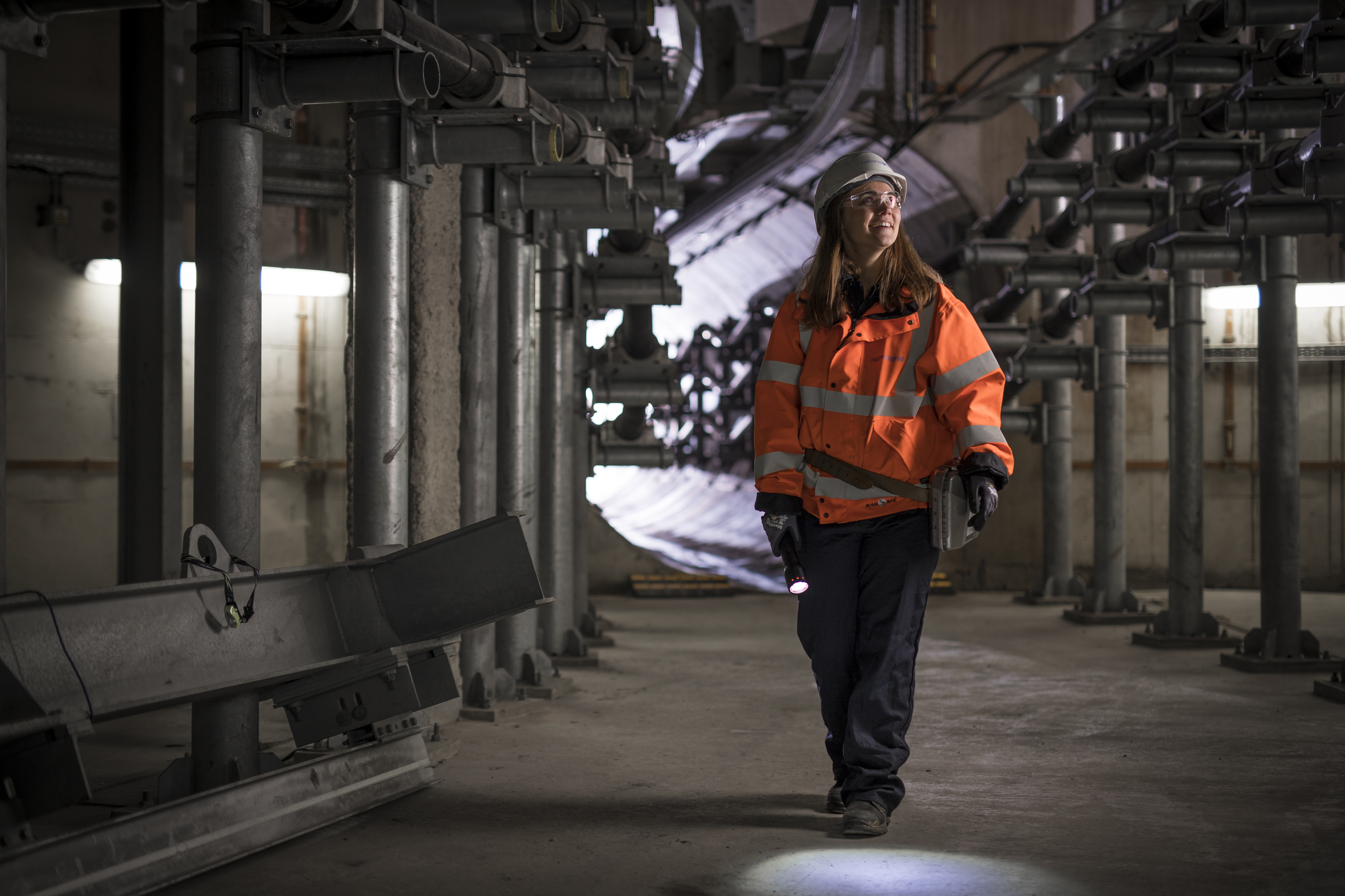 Female grad working in London Power Tunnels