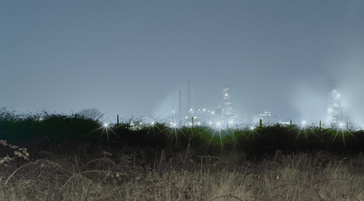 Lights from Steelworks in the distance at night