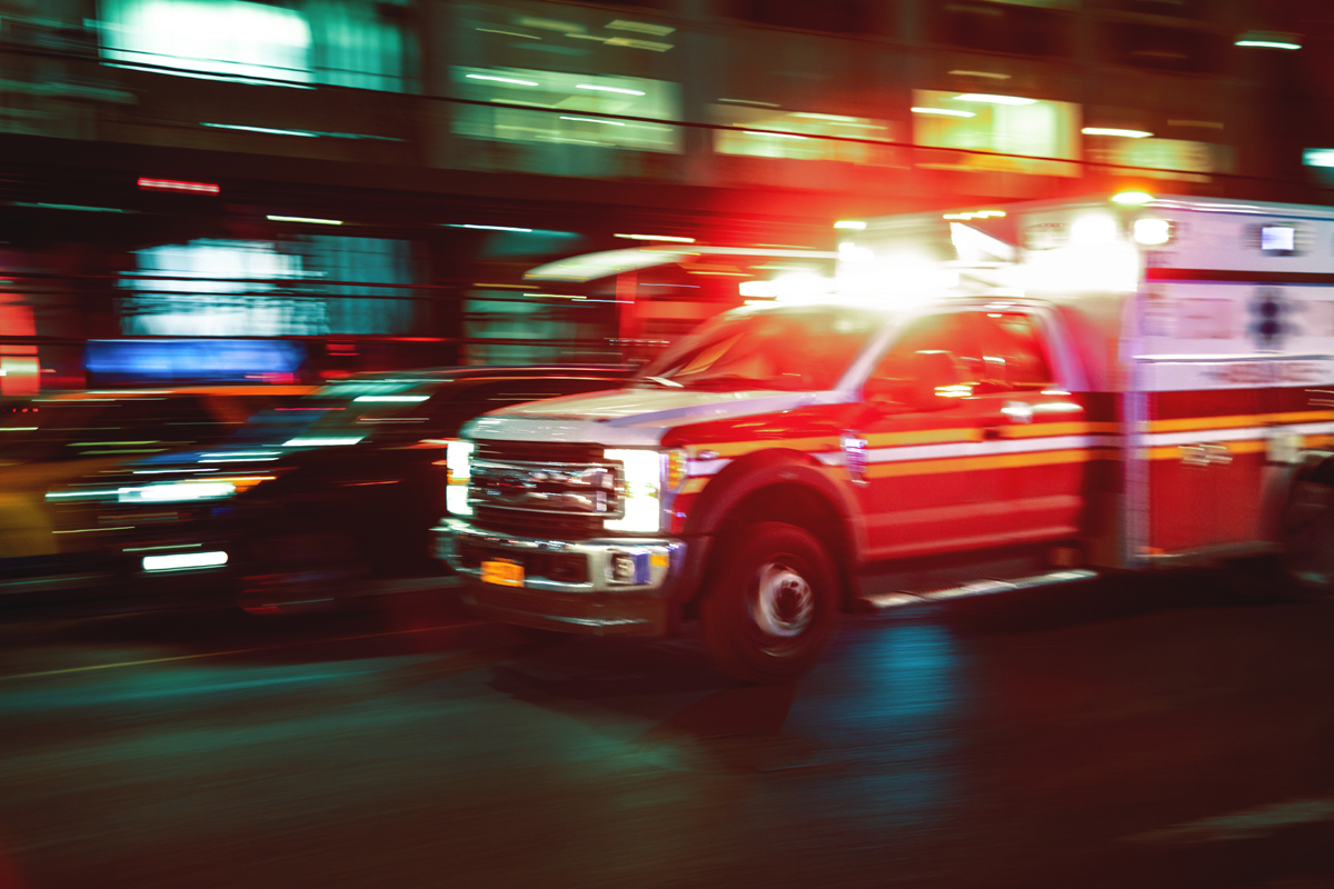Blurred image of a US ambulance in motion - used for the National Grid story 'Powering healthcare in New York'