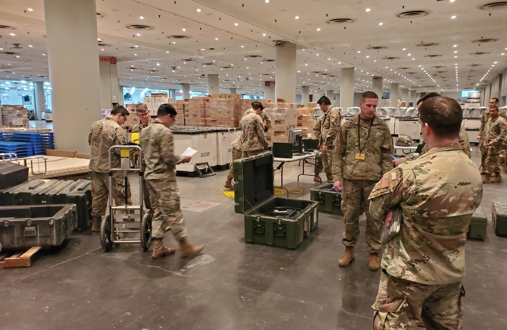 US military personnel in warehouse serving for National Guard - used for 'From National Grid to National Guard' story