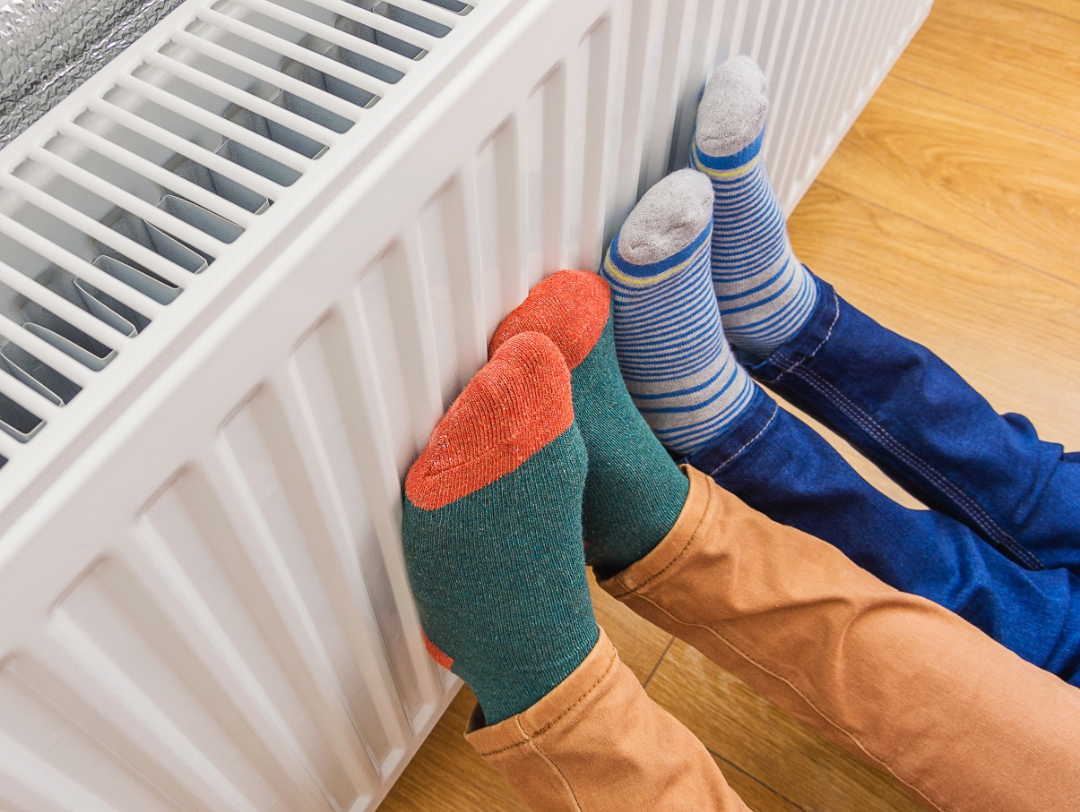 Feet in brightly coloured socks on radiator for National Grid article on Fuel Poverty Awareness Day