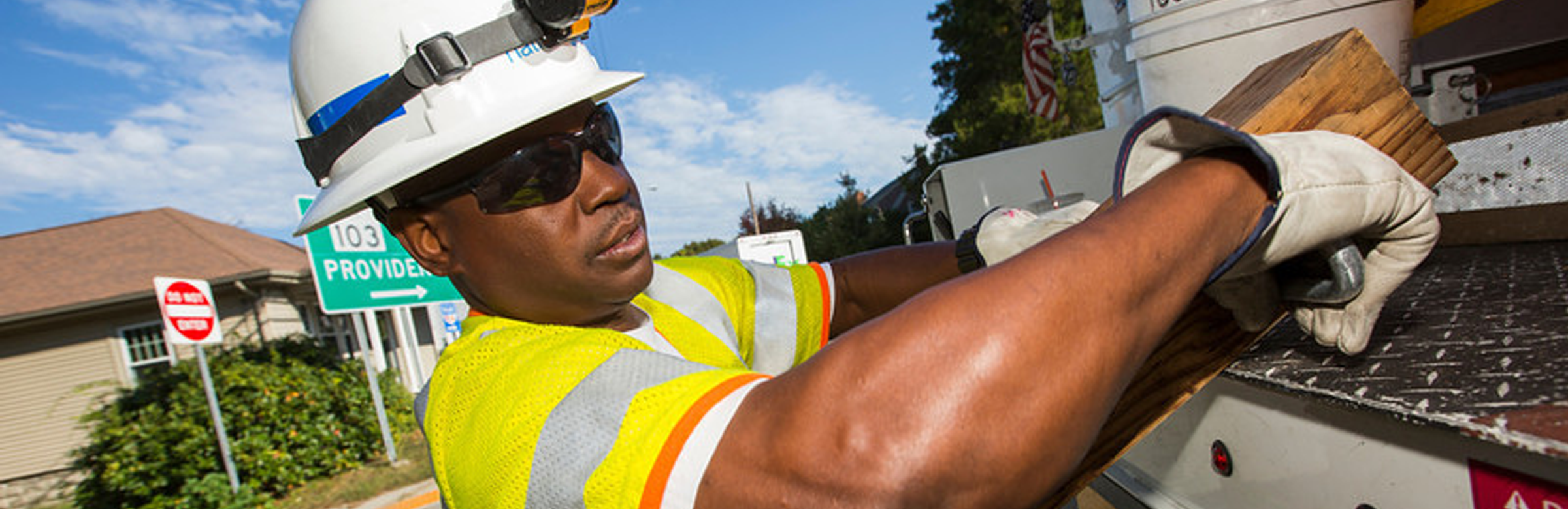 National Grid worker removing equipment from a truck- Our values