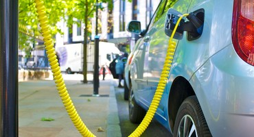 Electric car charging in street for National Grid article