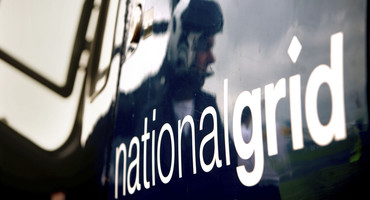Man with headphones reflected on the side of National Grid helicopter - used for the National Grid story '8 things you (probably) didn't know about National Grid'