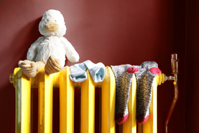 Cuddly duck and socks on radiator
