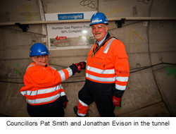 Councillor Pat Smith, Mayor of The East Riding of Yorkshire, shaking hands with Councillor Jonathan Evison, Mayor of North Lincolnshire, in the tunnel - used for the National Grid story 'Celebrating the completion of the Humber Tunnel