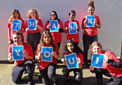 Young people holding letters spelling Thank You for National Grid virtual interview skills story