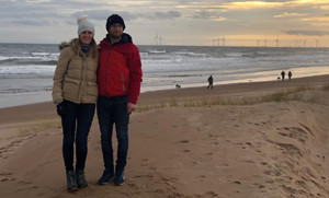 Laura Rainey and partner on the beach - for National Grid's Green Collar Jobs series