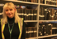 Information Records Manager Kerry Moores in the National Grid archive - used in the National Grid story 'Time travelling through the history of energy at the National Grid archive'