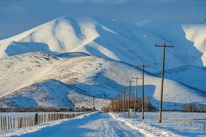 Snow covered road and mountain for National Grid article