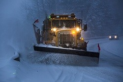 Snowplow in snowy conditions for National Grid article Holiday Heroes