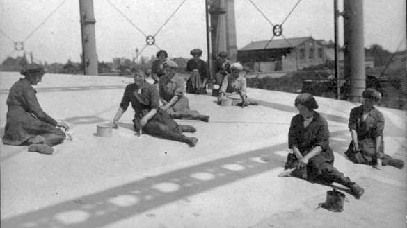 Archive image of women painting the top of a gas holder - used in the National Grid story 'Time travelling through the history of energy at the National Grid archive'