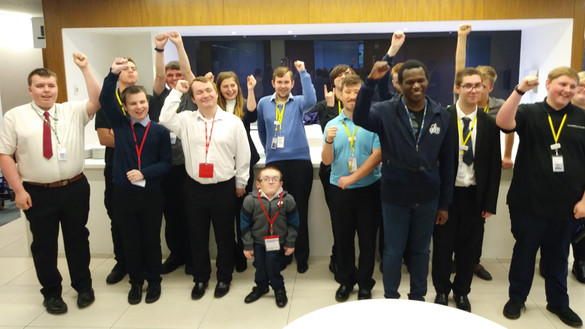 EmployAbility interns celebrating with hands in the air - used for the National Grid story 'EmployAbility supported internships: helping young people with learning disabilities get into employment'