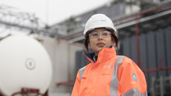 Female engineer in PPE for launch of National Grid Ventures IFA2 Interconnector