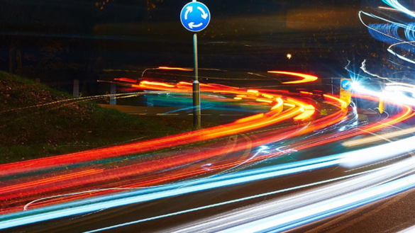 Night-time image of a busy road and traffic lights in a city - Traffic Light