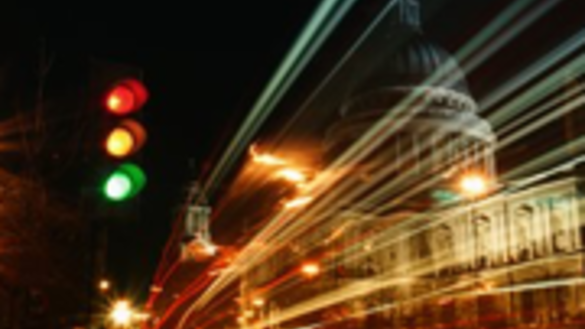 Night-time image of a busy road and traffic lights in a city - Corporate Governance