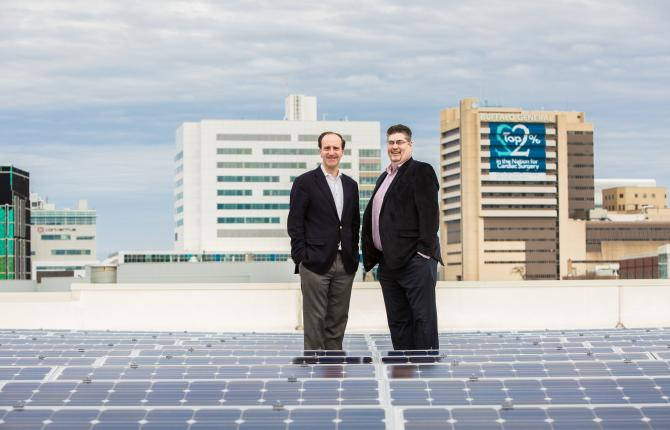 Two National Grid representatives standing in front of a building-skyline