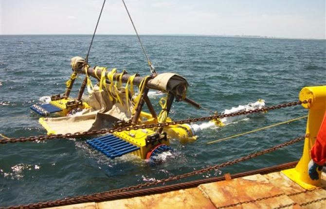 Industrial equipment being lowered into the ocean