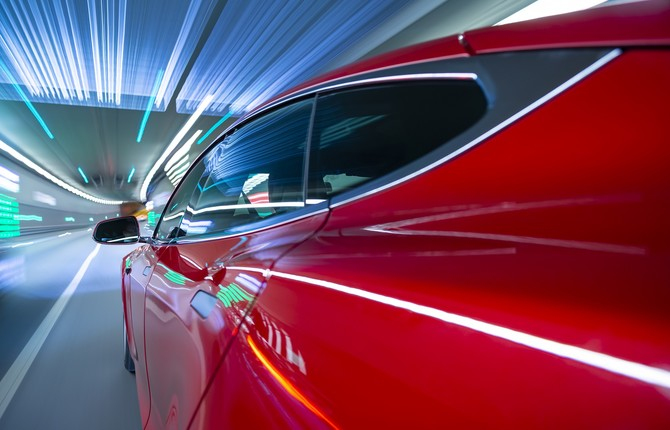Red EV at speed through tunnel for National Grid article
