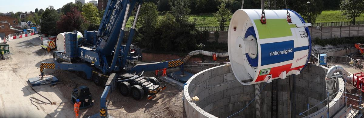 A National Grid construction site with equipment being lowered into a tunnel