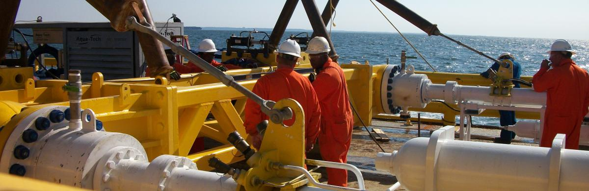 National Grid employees working on a gas rig with the ocean in the background