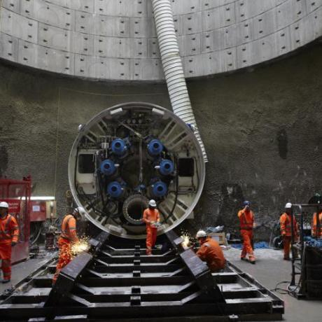 Several Gas industry workers using a tunnel boring machine