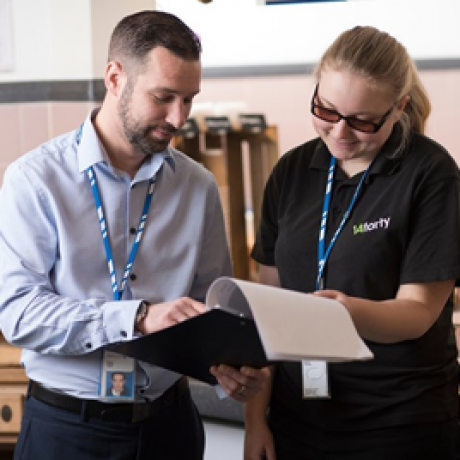 Two National Grid employees looking at a clipboard - Employability Image